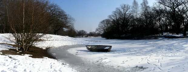 Boat on a frozen Hollow Pond