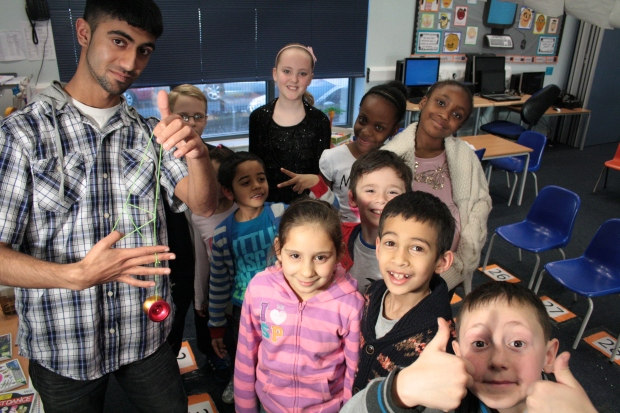 Fixer Aadam discussses his Fix with pupils at Barclay Primary School, Leyton